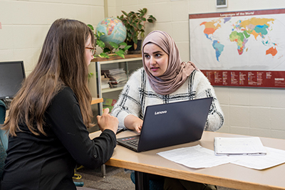 International student practicing English in the English Language Learner Support Center.