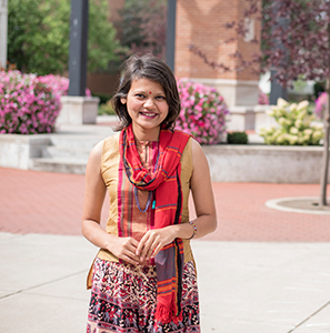 Journalism and digital media international student poses for photo on campus.