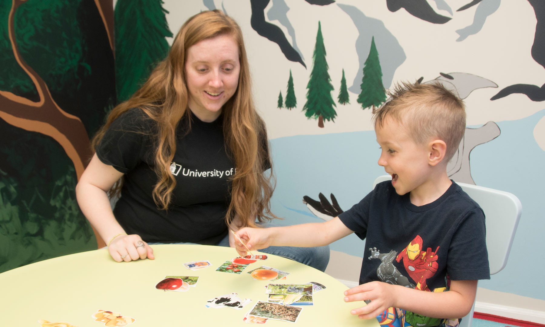 Findlay student plays game with elementary school aged child